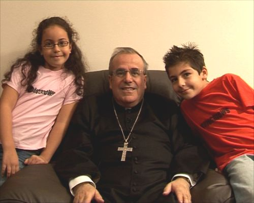 Archbishop Pawl Cremona with children