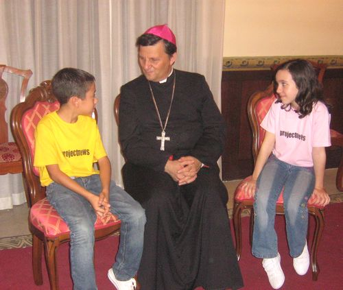 Gozo Bishop Mario Grech with children