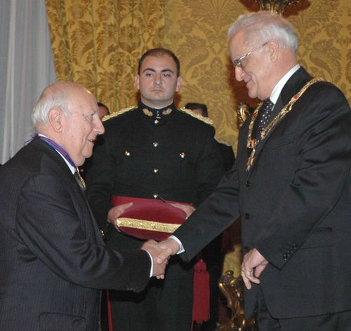 Anton Tabone receiving the K.O.M from the President of Malta