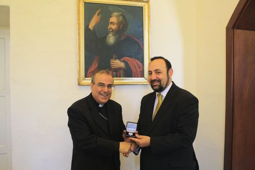 Silver Replica St Paul Stamp presented to Archbishop