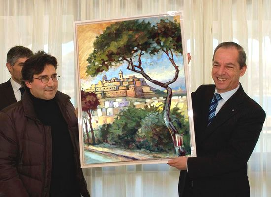 George Scicluna presents painting to the Prime Minister