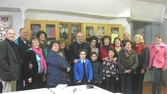 Sannat Priest's books presented to Adelaide Maltese School