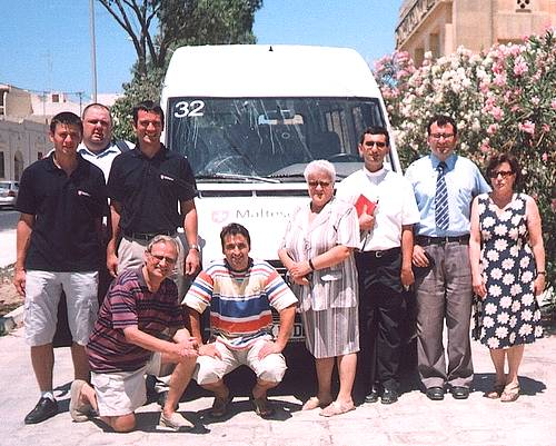 Malteser delegation donates two tail lift minibuses in Gozo