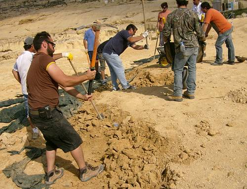 Now workers wield pickaxes to break up the Dwejra sand