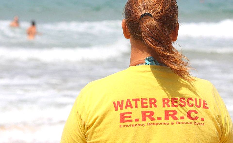 ERRC lifeguards assist an elderly woman in Marsalforn Bay