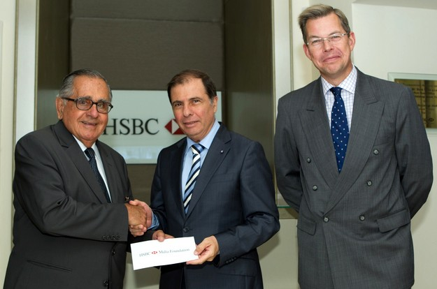 HSBC presents a donation to the President for the MCCF