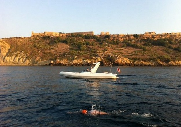 Kurt Arrigo finishes the round Gozo charity swim in 12 hours