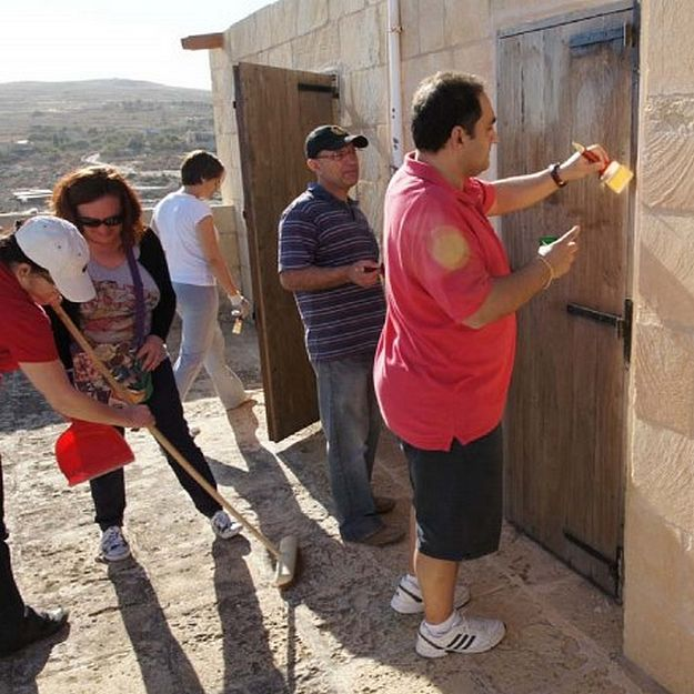HSBC Gozo staff volunteer their time with Wirt Ghawdex