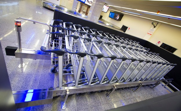 Malta Airport new luggage trolleys, cost €2 to use - €1 will be refunded