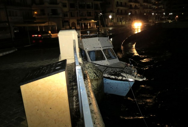 Stormy weather tosses boat up alongside Marsalforn promenade