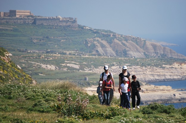 Gozo charity hikers enjoy perfect weather for hike to Xlendi