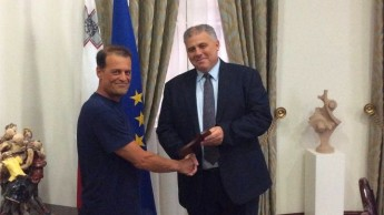 Gozo ferry worker Carmelo Buttigieg presented with commemorative plaque