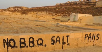 No BBQ signs carved and painted into walls and rock at Gozo salt pans