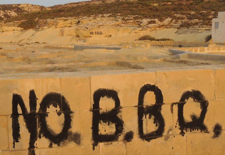 No BBQ signs carved and painted into walls and rock at the salt pans