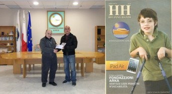 €8000 presented to Dar Arka through sales of Helping Hand Magazine