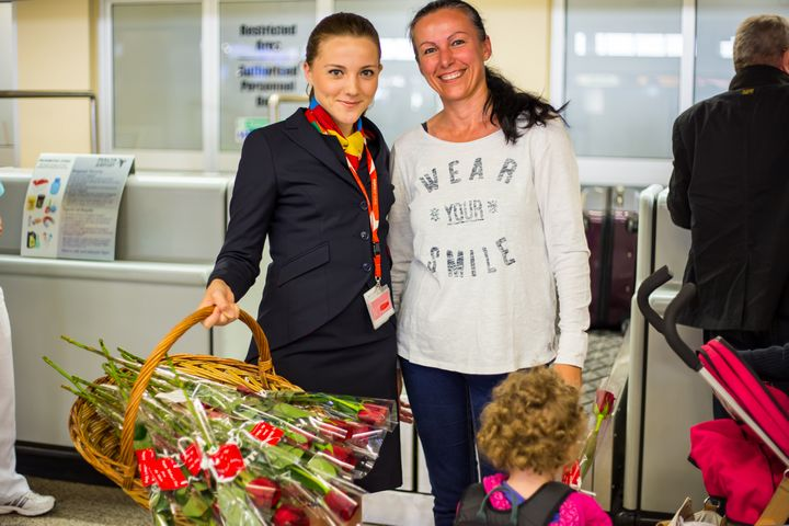 Air Malta Celebrates Mother's Day by giving out red roses