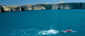 Michelle Muscat completes her swim for charity across the Gozo Channel