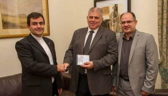 Vicenzo Caruana Spiteri CD presented to the Minister for Gozo