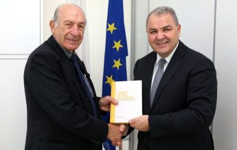 Speaker presented with the book `A Man of Cultural Achievements'