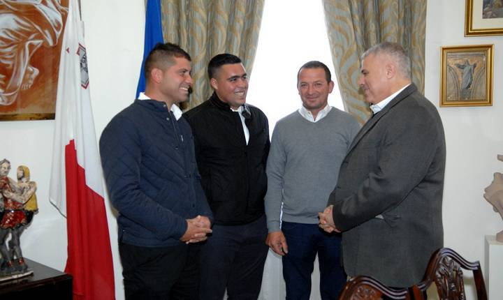Three Gozitan's presented with their new builders license