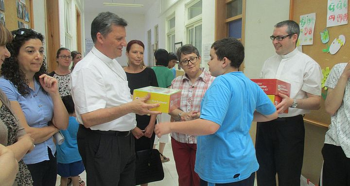 Gozo Bishop presents Catechism kits to students at Sannat Special Unit