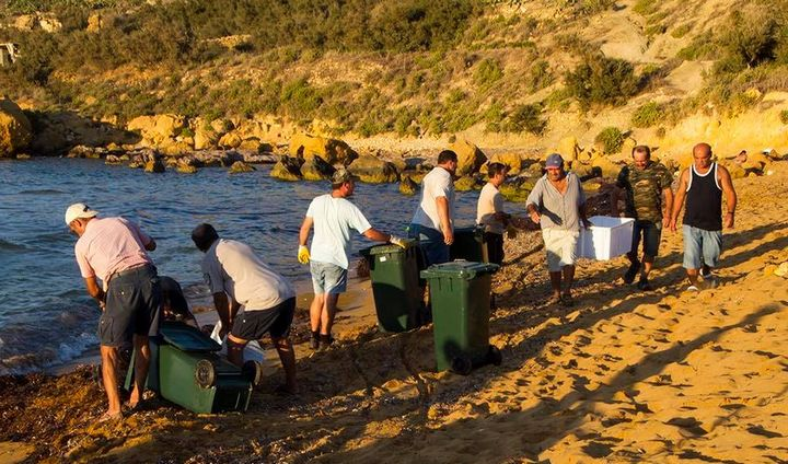 Algae cleared away from along the shoreline at Ramla Bay Gozo
