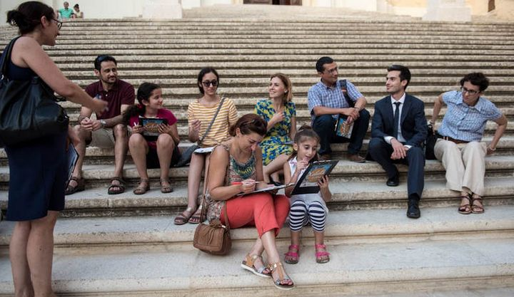 Family writing activity enjoyed in the historic surroundings of the Citadel