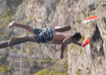 Slippery pole competition entertains the crowds in Xlendi Bay