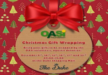 Christmas Gift Wrapping Corner for charity with OASI volunteers