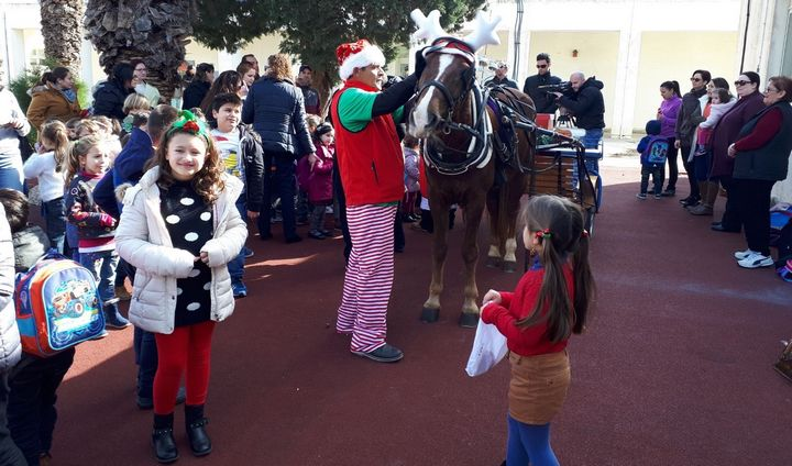 Father Christmas makes surprise visit to children at Gharb Primary