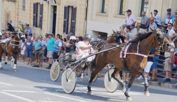 Large crowds line Republic Street for Santa Marija Horse Races