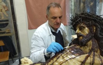 Gozitan working as Head Conservator on Ta' Giezu Crucifix