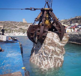 Dangerous concrete boulders removed from Hondoq Bay